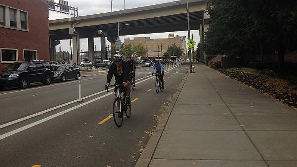 Bike riders on Penn Avenue protected bike lane - PHOTO COURTESY OF BIKE PITTSBURGH