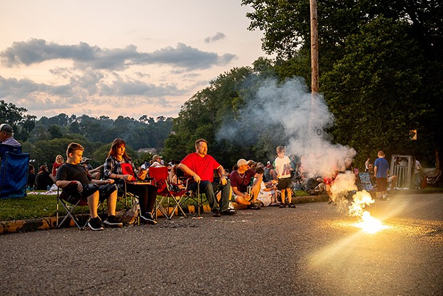 People set off small fireworks before the Dormont Day fireworks during the Fourth of July Celebration. - CP PHOTO: KAYCEE ORWIG