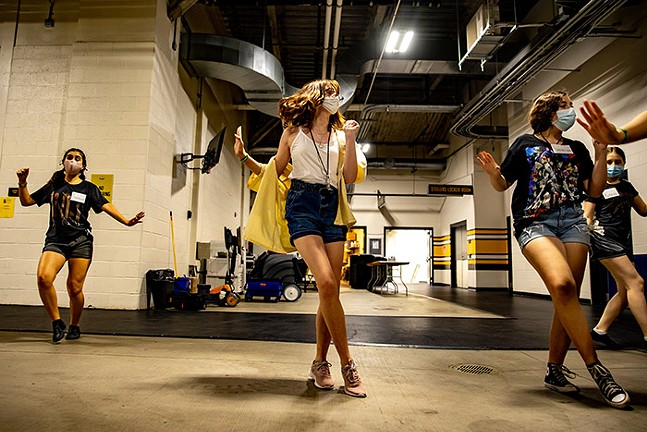 The Youth Ensemble practices a dance inside Heinz Field. - CP PHOTO: KAYCEE ORWIG
