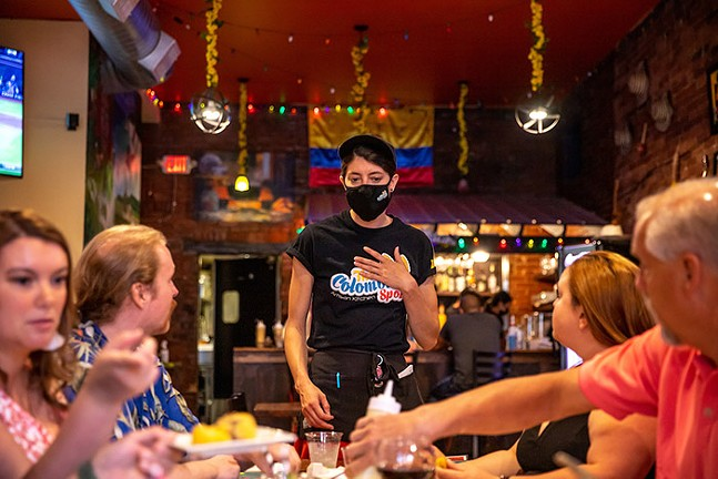 Customers enjoy a meal at The Colombian Spot in the South Side. - CP PHOTO: KAYCEE ORWIG