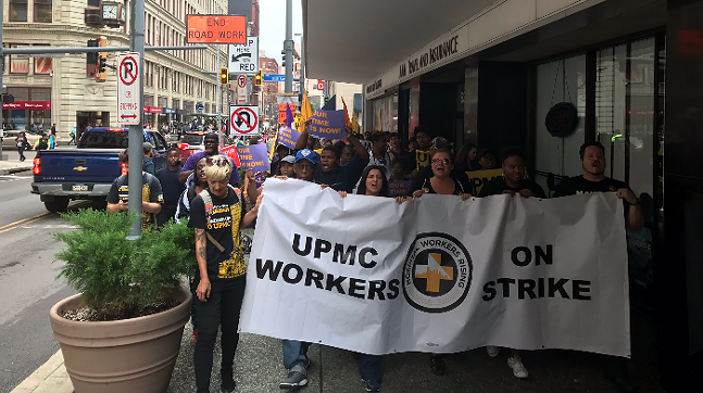 UPMC workers on a one-day strike in 2018 in Downtown Pittsburgh - CP PHOTO: RYAN DETO