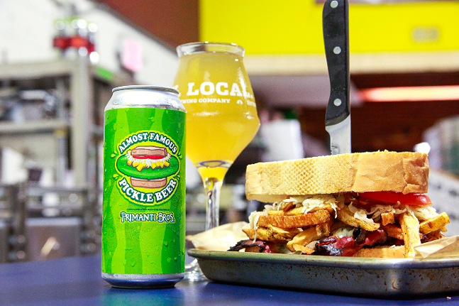 The Almost Famous Pickle Beer next to a Primanti Bros sandwich - PHOTO: COURTESY EAST END BREWING