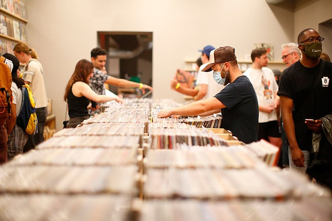 Customers browse through records at the Government Center. - CP PHOTO: JARED WICKERHAM