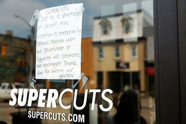 A sign hangs on the door of Supercuts in the South Side on Thu., Aug. 12. - CP PHOTO: JARED WICKERHAM