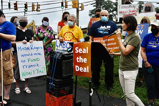 Laura Chu Wiens, Executive Director of Pittsburghers for Public Transit, speaks during a #SealTheDeal rally. - PHOTO: TOM HOFFMAN