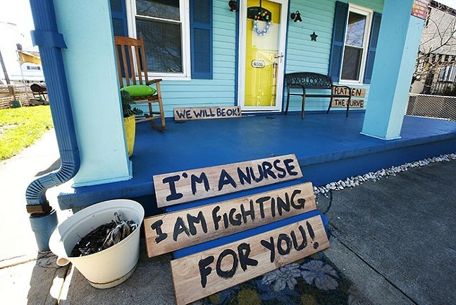 Signs on a front porch in Stanton Heights, spring 2020 - CP PHOTO: JARED WICKERHAM