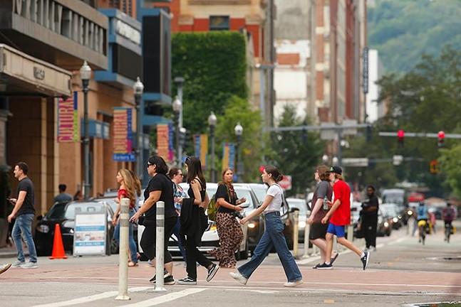 People walk through Downtown Pittsburgh on Thu., Aug. 18. - CP PHOTO: JARED WICKERHAM