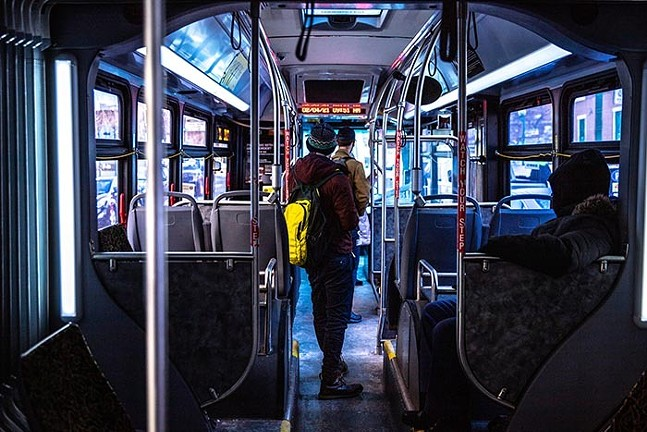 Riders standing on a Port Authority bus - CP PHOTO: KAYCEE ORWIG