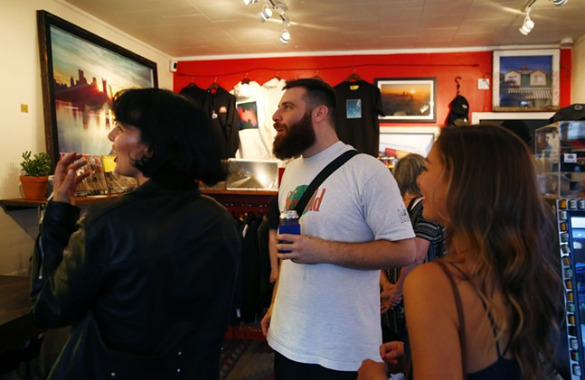 Justin Boyd talks with attendees of Proper Nouns at Bankrupt Bodega in Bloomfield. - CP PHOTO: JARED WICKERHAM