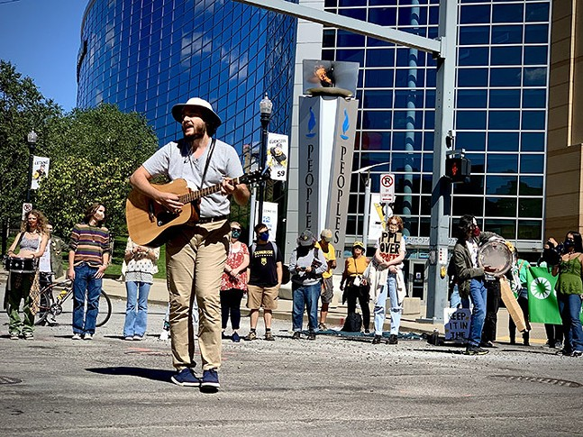 Edwin Everhart leads the crowd in three songs in front of PPG Paints Arena - CP PHOTO: KIMBERLY ROONEY