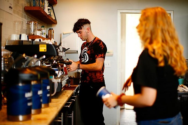 Barista Mark Phillips makes a coffee at Carnegie Coffee Company. - CP PHOTO: JARED WICKERHAM