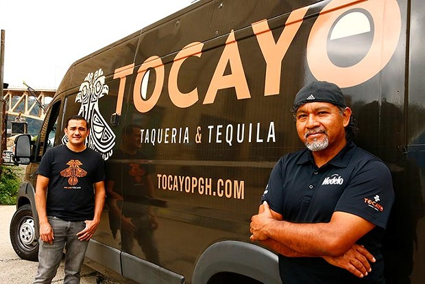 Owner Juan Grimaldo and Gabriel Fuerte, manager of operations, pose for a portrait with the Tocayo Food Truck. - CP PHOTO: JARED WICKERHAM