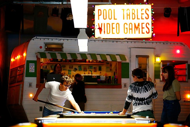 Jack, Jonah, and Maggie Paice play pool at Coop de Ville in the Strip District. - CP PHOTO: JARED WICKERHAM