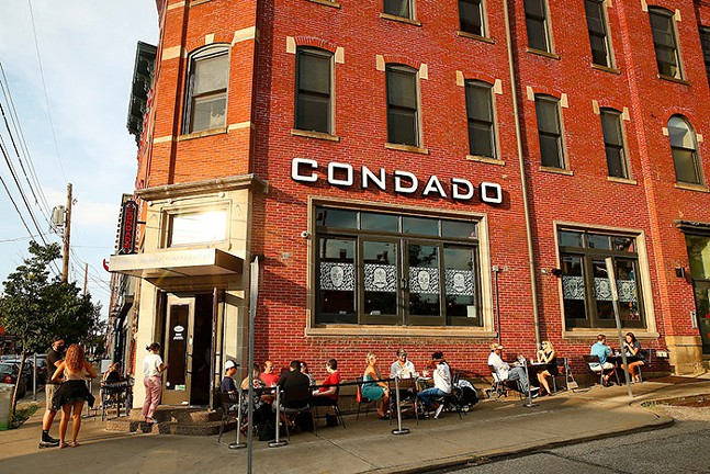 Patrons dine outside of Condado Tacos in Lawrenceville in June 2020. - CP PHOTO: JARED WICKERHAM