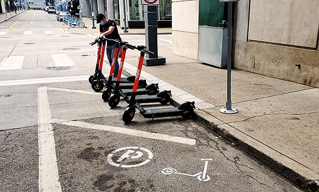 A scooter being parked in a designated parking corral in Downtown Pittsburgh - CP PHOTO: LUCY CHEN