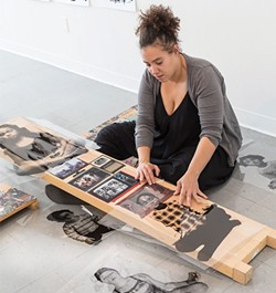 Pittsburgh artist Alisha Wormsley works on her piece for AIR's Active Voice, a project in response to the new administration. - CP PHOTO BY RENEE ROSENSTEEL