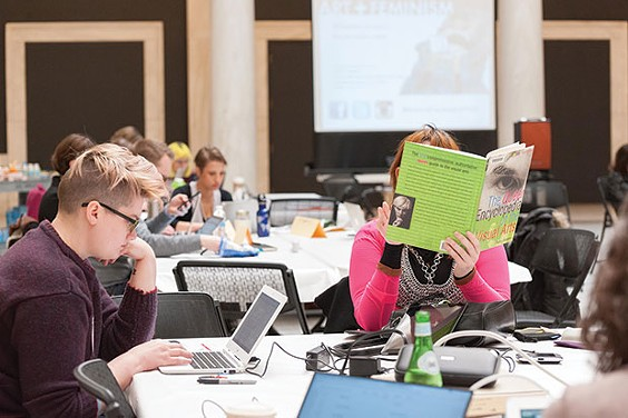 Participants update Wikipedia articles about underrepresented artists using resources from local libraries. - PHOTO COURTESY OF BRYAN CONLEY, CARNEGIE MUSEUM OF ART