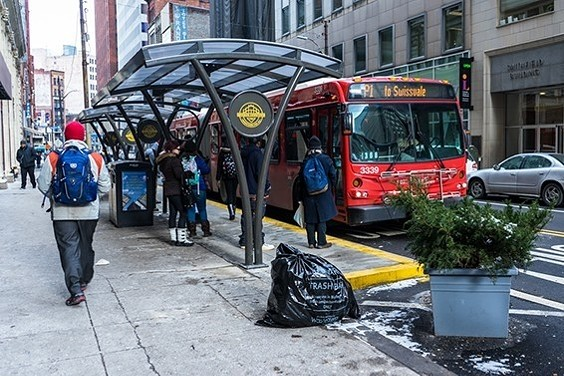 Port Authority bus picking up riders - CP PHOTO BY AARON WARNICK
