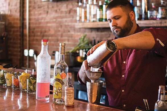 Tim Garso, of Smallman Galley, makes this month's special, the Ace of Spades - CP PHOTO BY KATHLEEN HAGERTY
