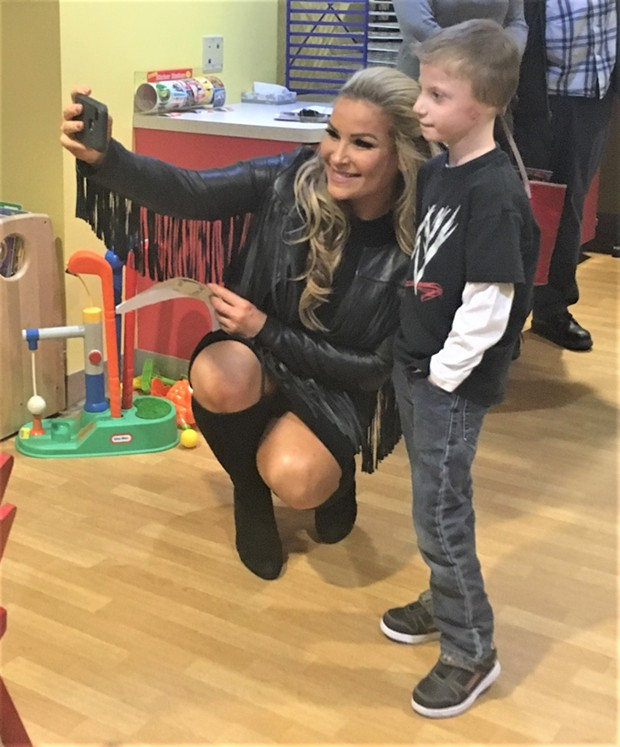 WWE's Natalya Neidhart takes a selfie with a young fan at Pittsburgh Children's Hospital Tuesday - PHOTO BY MEG FAIR