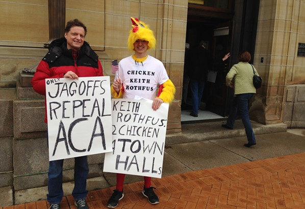 Darwin Leuba (right) says U.S. Rep. Keith Rothfus is a chicken for not holding a town hall. - CP PHOTO BY RYAN DETO