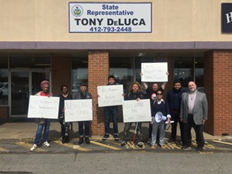 Immigrant-rights advocates protesting outside of state Rep. Tony DeLuca's office in Penn Hills - PHOTO COURTESY OF THOMAS MERTON CENTER