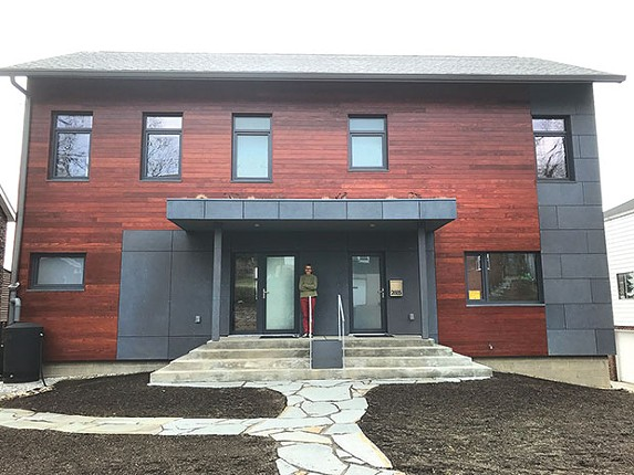 Lucyna de Barbaro on the front step of her new passive house, in Squirrel Hill - CP PHOTO BY BILL O'DRISCOLL