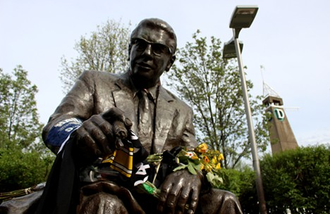 Fans left items at the statue of Art Rooney to honor former Steelers owner Dan Rooney - CP PHOTO BY BILLY LUDT