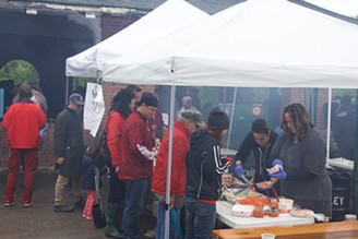 Revelers take a break from the music to grab some food. - CP PHOTO BY KRISTA JOHNSON