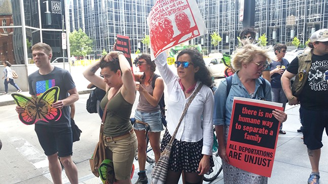 Protest outside the offices of DCK Worldwide - CP PHOTO BY REBECCA ADDISON