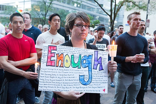 June 13, 2016, vigil in Pittsburgh for victims of the mass shooting at Pulse Nightclub in Orlando, Fla. - CP PHOTO BY JOHN COLOMBO