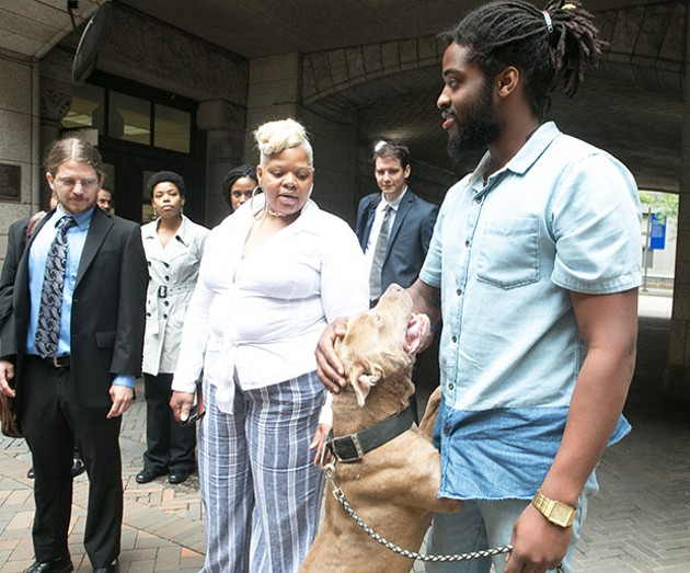 Pit bull King with his owners during a press conference at the Allegheny County Courthouse on Wed., June 7. - CP PHOTO BY JOHN COLOMBO