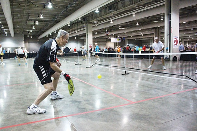 A player returns a serve during a recent pickleball tournament Downtown. - CP PHOTO BY BILLY LUDT