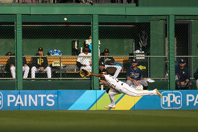 Center fielder Andrew McCutchennarrowly misses a diving catch at the waning track.