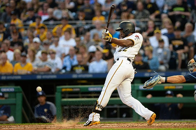 Andrew McCutchen fouls off a ball into the dirt. He scored twice on two walks in yesterday's game.