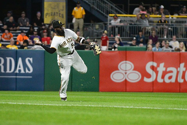Left fielder Josh Harrison makes an off-balance throw from the outfield.