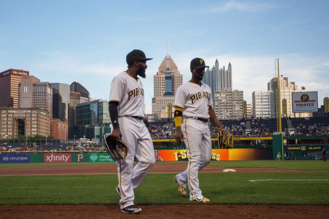 Left fielder Josh Harrison and center fielder Andrew McCutchen walk back into the dug out between innings.
