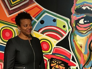 Janis Burley Wilson stands before a mural by Tarish Pipkins at the August Wilson Center. - CP PHOTO BY BILL O'DRISCOLL