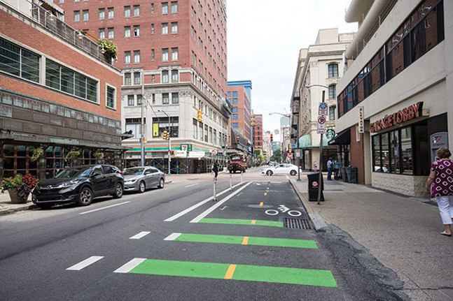 Bike lane on Penn Avenue in Downtown Pittsburgh - CP PHOTO BY JAKE MYSLIWCZYK