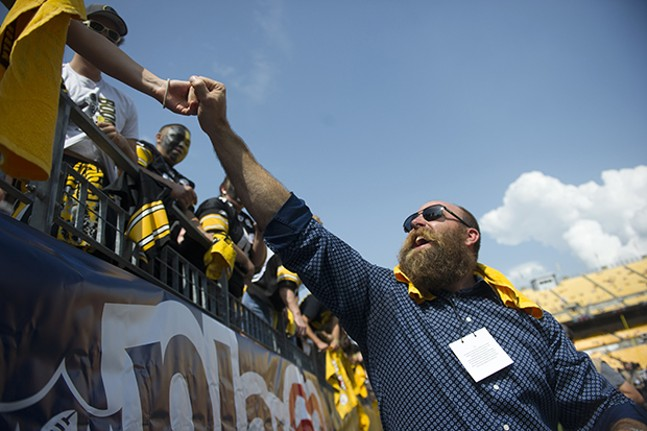 Former Steelers defensive back Brett Keisel embraces some fans prior to the Steelers opening day victory.
