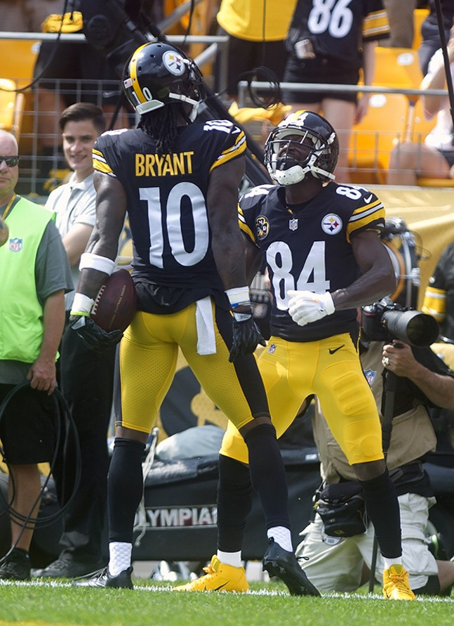 Antonio Brown celebrates with teammate Martavis Bryant after Bryant scored a touchdown during the first quarter of the game.