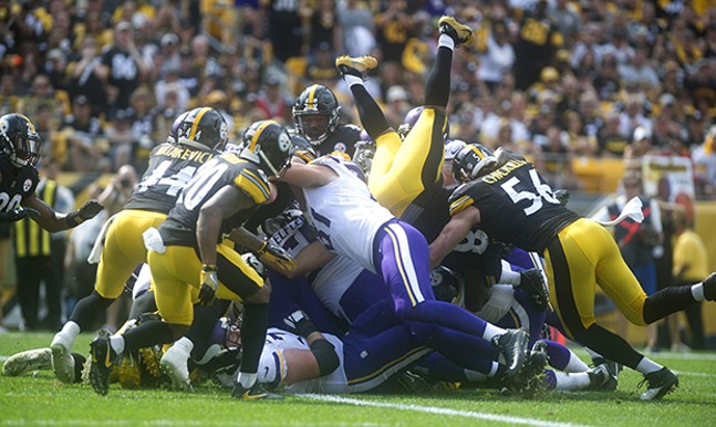 Steelers Vince Williams goes feet first but is unable to prevent the Vikings' only touchdown of the game.