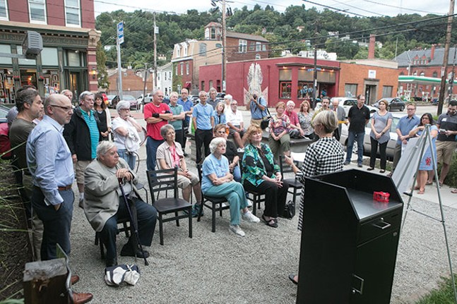 Old-time South Siders gather to rededicate a memorial to Charlie Samaha. - CP PHOTO BY JOHN COLOMBO