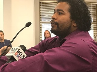 Jonathan Reyes, of McKeesport, an arts and culture facilitator at the Carnegie Library in Braddock, advocates removal of the Foster statue at last night's Arts Commission hearing. - CP PHOTO BY BILL O'DRISCOLL