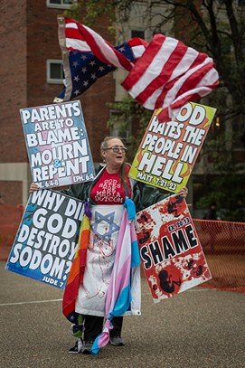 A member of the Westboro Baptist Church protests outside CMU - CP PHOTO BY MARANIE STAAB