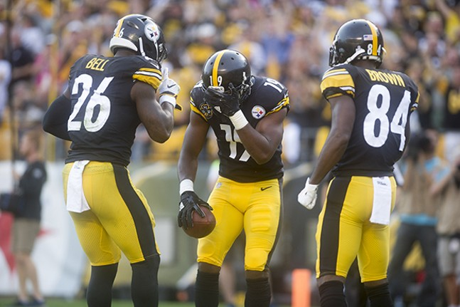After scoring a touchdown, wide receiver JuJu Smith-Schuster plays a game of hide-and-seek with teammates Le'Veon Bell and Antonio Brown.