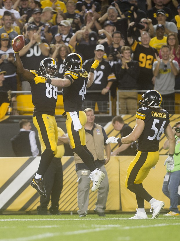 Darrius Heyward-Bey celebrates with Tyler Matakevich after catching a pass to seal the Steelers 29-14 victory.