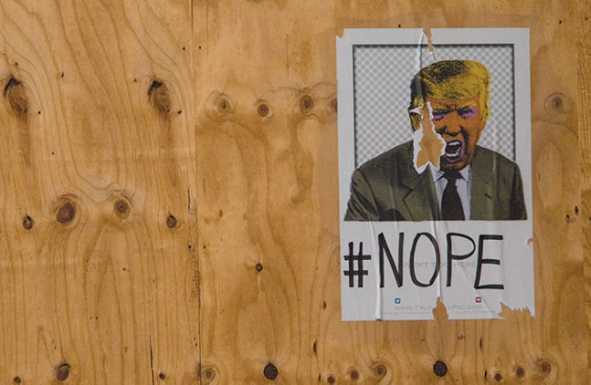 Anti-Trump street art in Pittsburgh - CP PHOTO BY LUKE THOR TRAVIS