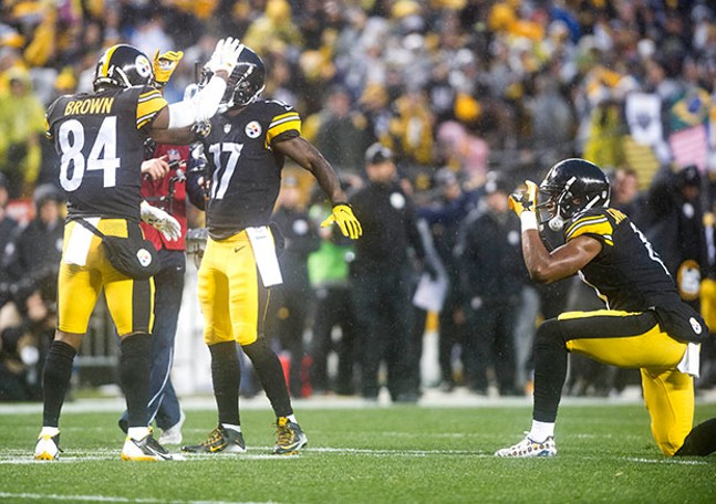 Wide receiver Juju Smith-Schuster, right, pretends to take a picture of Antonio Brown and Eli Rogers celebrating after Rogers' touchdown.
