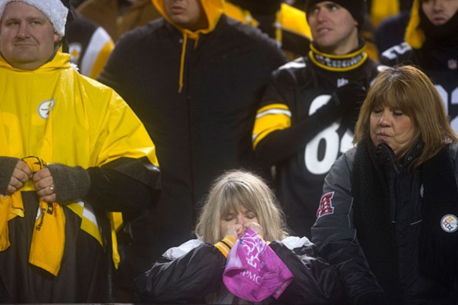 Pittsburgh Steeler fans try to control their emotions after the Patriots took the lead late in the game.